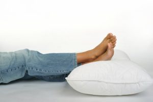 foot-on-pillow-1