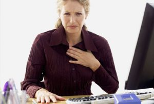 getty_rf_photo_of_woman_with_heartburn_at_work-1